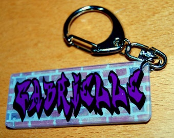 Key chain name of your choice purple graffiti on brick wall background