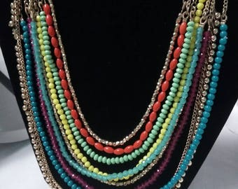 Multi colored Nine strands of beads and chains vintage necklace