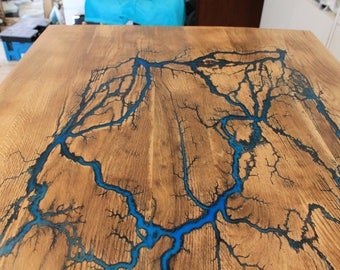SOLD!  Table by the Carpenter dining table with unikalem Flash motif shines in dark wood solid oak Lichtenberg figure