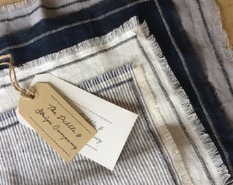 Blues and stripe linen napkins with navy stitch and frayed edge. Set of 4