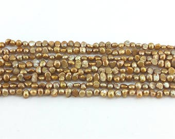 """Light gold freshwater pearls 4x5mm beads full 15.5"""" strand - flat sided potato cultured"""