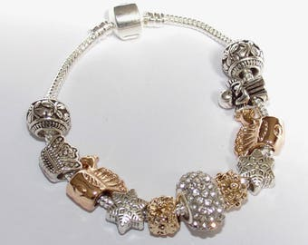 "STUNNING silver Bracelet with gold charms ""Pandora style"""