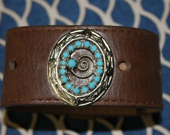 Leather cuff bracelet with a turquoise and silver vintage brooch