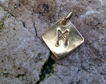 Runic amulet with rune Manaz, made of brass