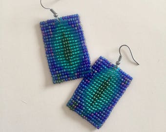 Deep blue and greenish beaded earrings to ward off patriarchy