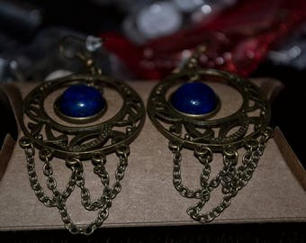 Earrings in bronze with blue stone