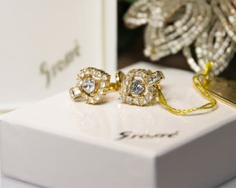 Vintage Henkel & Grosse - Heart clip on earrings from the 80s gold plated with crystal clear rhinestones - Ohrclips vergoldet in Herzform