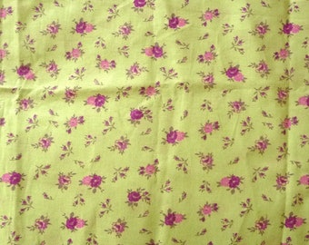Fabric flowers on green background