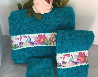 Decorative teal with flower and bird Trim Towels