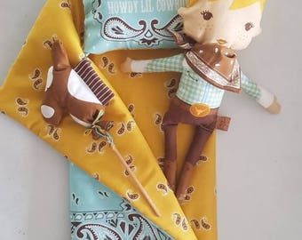 Cowboy with horse, pillow and quilt.