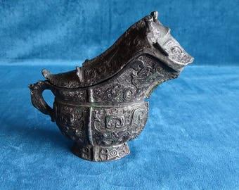 Bronze ceremonial wine jug with taotie animals-China-19th century