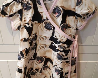 Girls 2-3 years wrap around Pug dress. Pink trim on Pug fabric