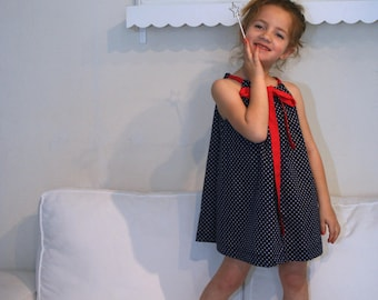 Dress blue Tulip with white dots with red bow