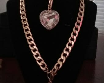Gold chain, heart stone set