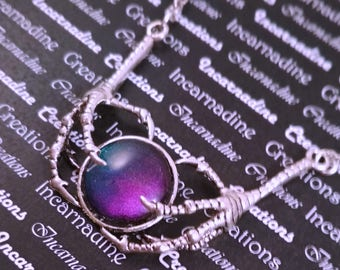 Silver handpainted color shifting glass bird claws necklace
