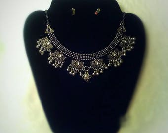 This one of a kind necklace comes with faux silver earrings