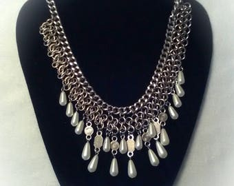 This one of a kind necklace has silver and faox pearls