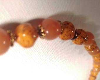Orange Beaded Necklace with Purple and Gold Detail