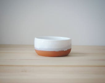 Clay bowl with white glaze. Candy bowl