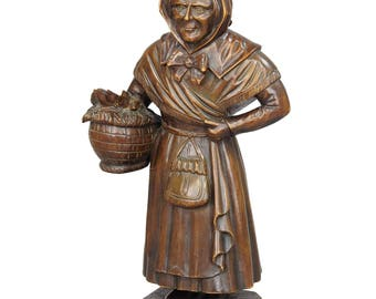 antique woodcarving sculpture of a folksy countrywoman