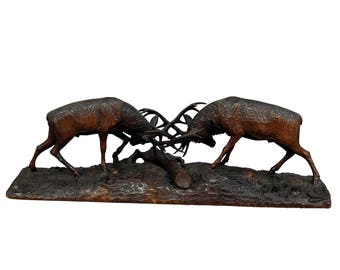 outstanding wooden carved fighting stags by k. bach 1946