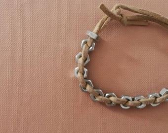 bracelet with metallic nuts , handmade , suede cord