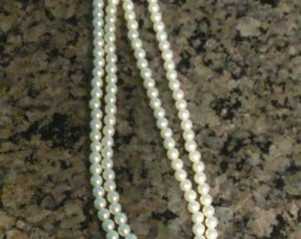 Pearl necklace with decorative clasp, double strand.