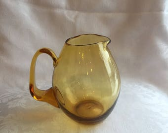 Vintage handblown amber glass pitcher