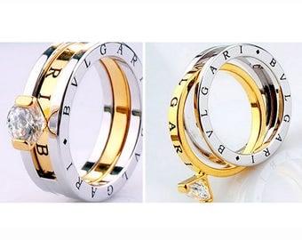 ITALY DESIGN trendy! brand new titanium ring with 18 yellow gold & AAA zircon Gr. 17