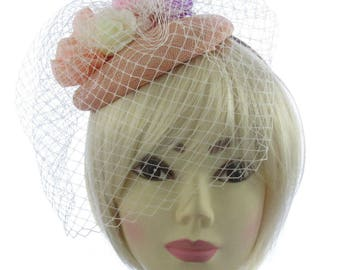 Peach hatinator/fascinator headband and netting. Special Events