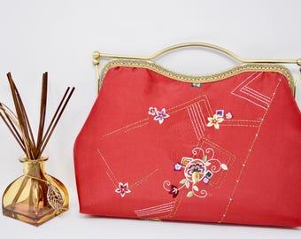 Red hand made embroidered silk handbag