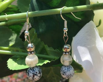 Black spotted earrings with metal and creme
