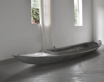 Antique aluminum canoe