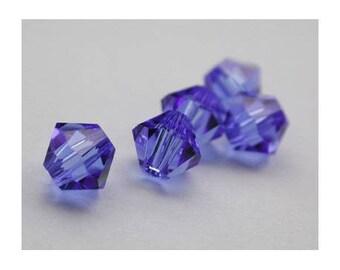 8 mm: 2 Swarovski Crystal bicone bead Sapphire - blue