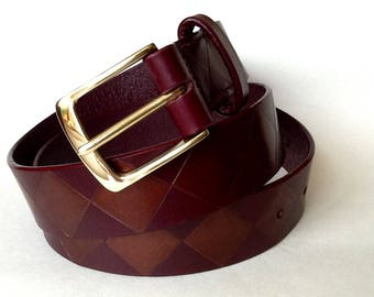 "1 1/4"" wide handmade hand painted burgundy leather belt with a solid brass buckle and decorated with a diamond design"