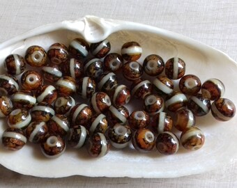 10 pearls 8 mm Maroon cats eyes