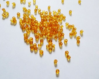 25 g seed beads glass transparent orange 4mm