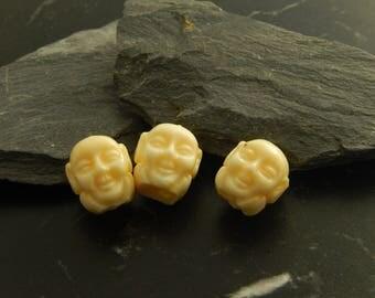 5 white Buddha head beads
