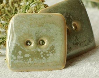 2 square buttons grey green speckled
