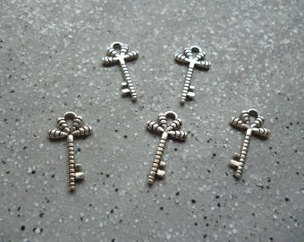 5 beautiful carved silver metal keys