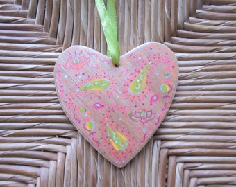 The charm of an Indian hand painted wooden heart