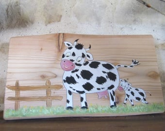 Cow and calf naive painting on wood