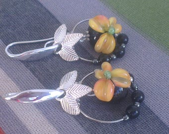 Pair of small flowers in yellow - orange to deep black beads and beaded hoops