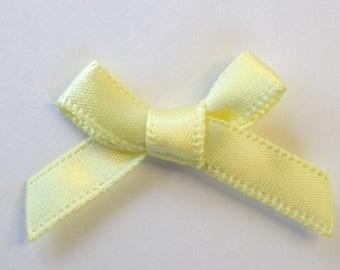 25 x 7mm Satin ribbon bow: yellow clear - 02357