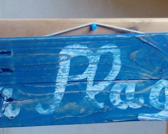 Blue branch wooden beach sign