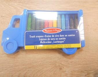 box of 12 crayons wax das a small box truck