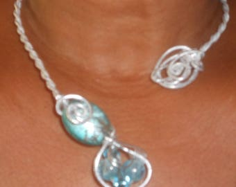 Ocean necklace silver ribbed aluminum wire and blue stones.
