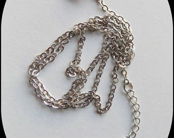 Silver mesh chain of 48 cm + 4, 5 cm adjusting chain.