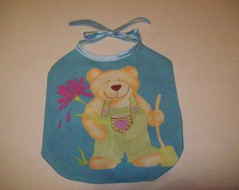 bib for Doll or doll cotton printed with a teddy bear gardener