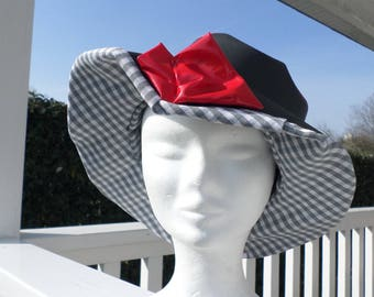 Red and gray vinyl rain hat lined with a cotton gingham woman